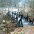 Small bridge on mountain river — Stock Photo
