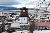 Bell tower above village in the winter — Stock Photo