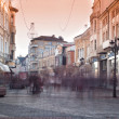 City street with shops, buildings and people — Stock Photo #38614927