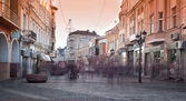 City street with shops, buildings and people — Stock Photo
