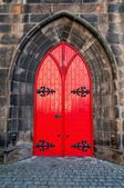 Wooden door in red — Stock Photo