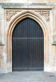Wooden door with arch — Stock Photo