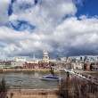 Urban landscape with St. Paul's Cathedral and Millennium Bridge — Stock Photo