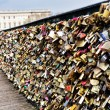Love padlocks, a tradition of the romantic Paris, representing eternal love of the couples, who lock padlocks on a bridge over the Seine river in Paris, France, MARCH 26, 2014 — Stock Photo