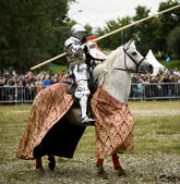 Knight on white horse — Stock Photo