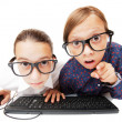 Young girls playing or working on a computer — Foto Stock
