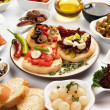 Table full of appetizers — Stock Photo