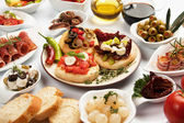 Table full of appetizers — Stockfoto