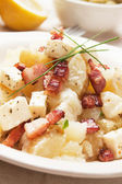Potato salad with cheese and bacon — Stock Photo
