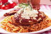 Chicken parmesan with spaghetti pasta — Stock Photo