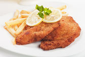 Viener schnitzel, breaded steak with french fries — Photo