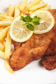 Viener schnitzel, breaded steak with french fries — Stock Photo