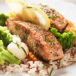 Grilled salmon steak vith cooked rice - Stock Photo