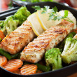 Grilled salmon steak and vegetables — Stock Photo #21311961