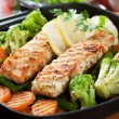 Grilled salmon steak and vegetables — Stock Photo