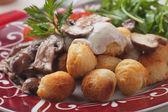 Roasted potato croquettes with portabello mushrooms — Stock Photo