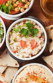 Couscous with spring onion and tomato — Stock Photo