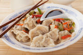Asian dumplings with vegetable and soy sauce — Stock Photo