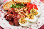 Deviled eggs with beans and sausage — Stock Photo