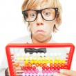 Stock Photo: Young boy with abacus calculator