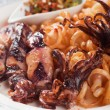 Stock Photo: Fried squid with italian pasta