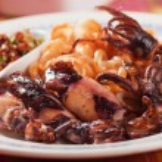 Fried squid with italian pasta — Stock Photo