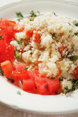 Couscous with herbs and tomato — Stock Photo