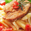 Viener schnitzel, breaded steak with french fries — Stock Photo #39350725