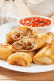 Egg rolls with tomato sauce — Stock Photo