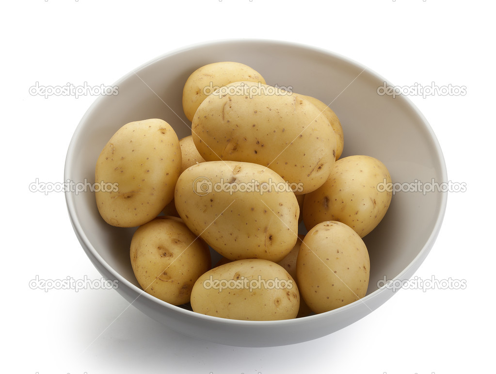 Some raw whole potatoes in the white bowl — Stock Photo #16848833