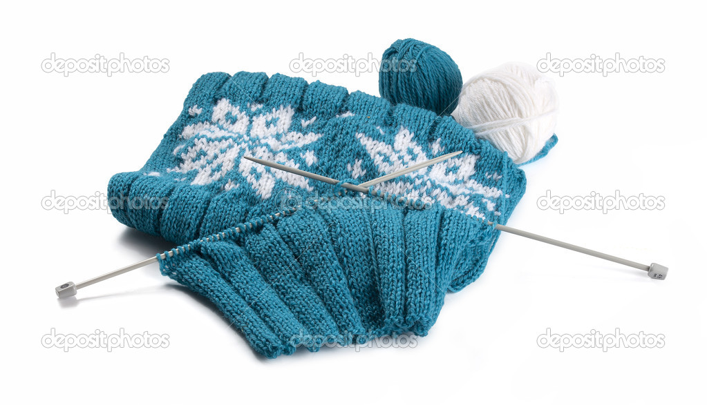 Turquoise knitting with clews and knitting needles on the white background — Stock Photo #16848853