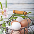 A basket full of eggs - Stock Photo