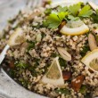 Quinoa salad with almonds and parsley - Stock Photo