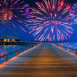 Festive New Years fireworks over the tropical island — Stock Photo