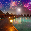 Festive New Year's fireworks over the tropical island — Stock Photo
