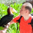 Portrait of the man with a toucan — Stock Photo