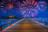 Festive New Years fireworks over the tropical island — Стоковое фото