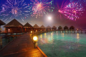 Festive New Year's fireworks over the tropical island — Stok fotoğraf