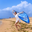 Attractive woman with a beach scarf in hands - Stock fotografie