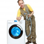 The repairman near the washing machine — Stock Photo
