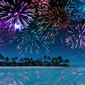 Festive New Year's fireworks over the tropical island — Stock fotografie