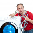 Stock Photo: Repairmnear washing machine