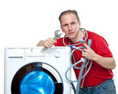 The repairman near the washing machine — Stock Photo