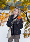 The woman in autumn park — Stock Photo
