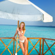 The beautiful woman under parasol near the sea — Stock Photo #13414161
