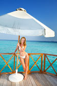 The beautiful woman under parasol near the sea — Stock Photo