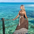 Stock Photo: Young womin long sundress on tropical beach. Polynesia. Island Tikehau.