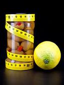 Olive and lemons and measuring tape- healthy food — Stock Photo