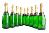 Sparkling wine bottles on a white background — Stock Photo