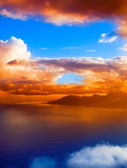 Aerial view. Mountain silhouette in the ocean at sunset. — Stock Photo